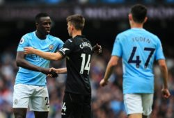 Benjamin Mendy of Manchester City shakes hands with Tom Carroll of Swansea City at full time