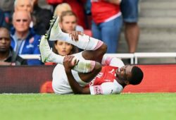 Ainsley Maitland-Niles of Arsenal lies injured before being replaced