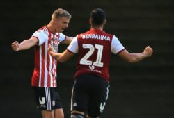 Marcus Forss of Brentford celebrates scoring the opening goal