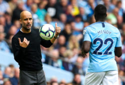Manchester City manager Josep Guardiola throws the ball to Benjamin Mendy of Manchester City
