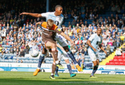 Marcus Forss of Brentford misses his kick under pressure from Blackburn Rovers Amari'i Bell  during the EFL Sky Bet Championship match between Blackburn Rovers and Brentford at Ewood Park, Blackburn