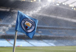 A general view as the corner flag receives a soaking from the sprinkler