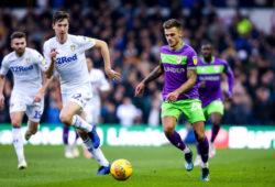 Jamie Paterson of Bristol City takes on Aapo Halme of Leeds United