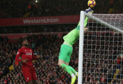 Everton goalkeeper Jordan Pickford fails to get the ball under control as Divock Origi of Liverpool waits to score the opening goal