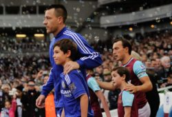 John Terry of Chelsea leads out the mascot for his 450th Chelsea appearance during the Barclays Premier League match between West Ham United and Chelsea played at The Boleyn Ground, London on October 24th 2015