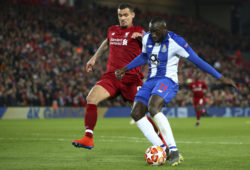 Porto's Moussa Marega attempts a shot at goal next to Liverpool's Dejan Lovren, left, during the Champions League quarterfinal, first leg, soccer match between Liverpool and FC Porto at Anfield Stadium, Liverpool, England, Tuesday April 9, 2019. (AP Photo/Dave Thompson)