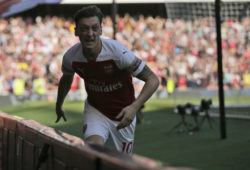 Arsenal's Mesut Ozil celebrates after scoring his side's opening goal during the English Premier League soccer match between Arsenal and Crystal Palace at the Emirates Stadium in London, Sunday, April 21, 2019. (AP Photo/Tim Ireland)
