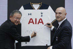 Tottenham Hotspur's Chairman Daniel Levy, right, and Ng Keng Hooi, Group Chief Executive and President Designate of AIA Group Ltd., sign autographs on a jersey during a news conference in Hong Kong, Thursday, May 25, 2017. Tottenham Hotspur football team will play a friendly match against local football team Kitchee. (AP Photo/Kin Cheung)