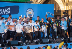 Thousands of Manchester City supporters gathered outside Manchester cathedral today 20/05/19 to celebrate the clubs record breaking season of 2018-19 in which Mancity won the Premier League trophy, the FA Cup, the Carabao Cup and the Womens FA cup. Manchester city football team are pictured lifting their trophies at the celebration. *** Local Caption *** 03820978