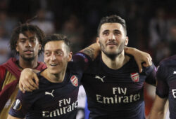 FILE - In this May 9, 2019 file photo, Arsenal defender Sead Kolasinac, right celebrates with Arsenal midfielder Mesut Ozil, left, at the end of the Europa League semifinal soccer match, second leg, against Valencia and Arsenal at the Camp de Mestalla stadium in Valencia, Spain. Arsenal academy head Per Mertesacker says there have been talks with players about the threat posed by gangs after Mesut Ozil and Sead Kolasinac had to fight off knife-wielding men. In an incident caught on camera in London last month, Kolasinac jumped out of a vehicle to confront the masked aggressors, who had pulled alongside the car on mopeds. (AP Photo/Alberto Saiz, File)  NYDD204