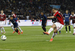 AC Milan forward Zlatan Ibrahimovic, of Sweden, scores on a penalty kick during a Serie A soccer match between Inter Milan and AC Milan, at the San Siro stadium in Milan, Italy, Sunday, May 6, 2012. (AP Photo/Luca Bruno)