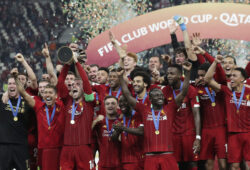 Players of Liverpool celebrate after winning the Club World Cup final soccer match between Liverpool and Flamengo at Khalifa International Stadium in Doha, Qatar, Saturday, Dec. 21, 2019. (AP Photo/Hassan Ammar)  PJO280