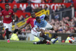 Manchester United's Aaron Wan-Bissaka and Manchester City's Raheem Sterling, right, compete for the ball during the English Premier League soccer match between Manchester United and Manchester City at Old Trafford in Manchester, England, Sunday, March 8, 2020. (AP Photo/Dave Thompson)  XPAG151