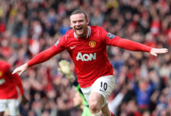 Manchester United's Wayne Rooney celebrates his goal during their English Premier League soccer match against West Bromwich Albion at Old Trafford, Manchester, England, Sunday, March 11, 2012. (AP Photo/Scott Heppell)