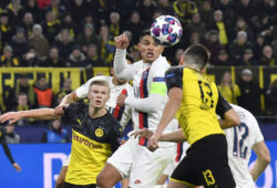PSG's Thiago Silva, centre, and Dortmund's Raphael Guerreiro duels for the ball during the Champions League round of 16 first leg soccer match between Borussia Dortmund and Paris Saint Germain in Dortmund, Germany, Tuesday, Feb. 18, 2020. (AP Photo/Martin Meissner)  XSG124