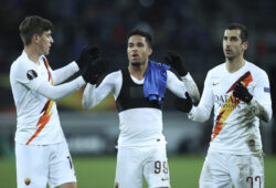 Roma's Justin Kluivert, center, celebrates with teammates Henrikh Mkhitaryan, right, and Gonzalo Villar at the end of the Europa League round 32 second leg soccer match between Gent and Roma at the KAA Gent stadium in Gent, Belgium, Thursday, Feb. 27, 2020. Roma won 2-1 on aggregate. (AP Photo/Francisco Seco)  FS128