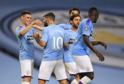 Manchester City's Phil Foden, left, celebrates scoring the third goal during the English Premier League soccer match between Manchester City and Arsenal at the Etihad Stadium in Manchester, England, Wednesday, June 17, 2020. The English Premier League resumes Wednesday after its three-month suspension because of the coronavirus outbreak. (Laurence Griffiths/Pool via AP)  TH200