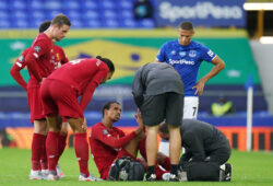 """FILE PHOTO: Soccer Football - Premier League - Everton v Liverpool - Goodison Park, Liverpool, Britain - June 21, 2020 Liverpool's Joel Matip receives medical attention, as play resumes behind closed doors following the outbreak of the coronavirus disease (COVID-19) Jon Super/Pool via REUTERS  EDITORIAL USE ONLY. No use with unauthorized audio, video, data, fixture lists, club/league logos or """"live"""" services. Online in-match use limited to 75 images, no video emulation. No use in betting, games or single club/league/player publications.  Please contact your account representative for further details./File Photo  X01545"""