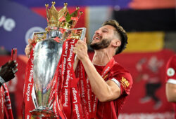 epa08561518 Liverpool?s Adam Lallana lifts the trophy as he celebrates the Premier League 2020 title following the English Premier League soccer match between Liverpool FC and Chelsea FC in Liverpool, Britain, 22 July 2020.  EPA-EFE/Paul Ellis/NMC/Pool EDITORIAL USE ONLY. No use with unauthorized audio, video, data, fixture lists, club/league logos or 'live' services. Online in-match use limited to 120 images, no video emulation. No use in betting, games or single club/league/player publications.
