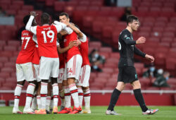 """Soccer Football - Premier League - Arsenal v Liverpool - Emirates Stadium, London, Britain - July 15, 2020 Arsenal's Reiss Nelson celebrates scoring their second goal with teammates as Liverpool's Andrew Robertson reacts, as play resumes behind closed doors following the outbreak of the coronavirus disease (COVID-19)  Glyn Kirk/Pool via REUTERS  EDITORIAL USE ONLY. No use with unauthorized audio, video, data, fixture lists, club/league logos or """"live"""" services. Online in-match use limited to 75 images, no video emulation. No use in betting, games or single club/league/player publications.  Please contact your account representative for further details.  X01348"""