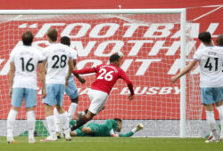 Manchester United's Mason Greenwood scores his side's opening goal during the English Premier League soccer match between Manchester United and West Ham at the Old Trafford stadium in Manchester, England, Wednesday, July 22, 2020. (Clive Brunskill/Pool via AP)  XDB179