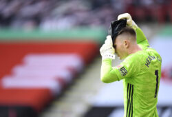 Sheffield United's goalkeeper Dean Henderson adjusts a cap on his head during the English Premier League soccer match between Sheffield United and Everton at Bramall Lane in Sheffield, England, Monday, July 20, 2020. (AP Photo/Peter Powell, Pool)  NYJC117