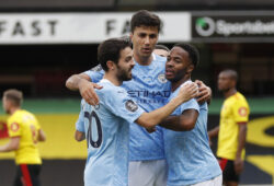 Soccer Football - Premier League - Watford v Manchester City - Vicarage Road, Watford, Britain - July 21, 2020 Manchester City's Raheem Sterling celebrates scoring their first goal with teammates, as play resumes behind closed doors following the outbreak of the coronavirus disease (COVID-19) Pool via REUTERS/Adrian Dennis EDITORIAL USE ONLY. No use with unauthorized audio, video, data, fixture lists, club/league logos or 'live' services. Online in-match use limited to 75 images, no video emulation. No use in betting, games or single club/league/player publications.  Please contact your account representative for further details.  X01348