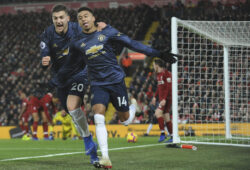 Manchester United's Jesse Lingard, right, celebrates with his teammate Diogo Dalot after scoring his side's opening goal during the English Premier League soccer match between Liverpool and Manchester United at Anfield in Liverpool, England, Sunday, Dec. 16, 2018. (AP Photo/Rui Vieira)