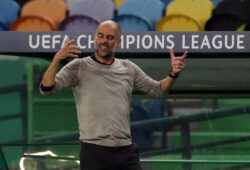 epa08606340 Headcoach Pep Guardiola of Manchester City reacts during the UEFA Champions League quarter final match between Manchester City and Olympique Lyon in Lisbon, Portugal 15 August 2020.  EPA-EFE/Miguel A. Lopes / POOL
