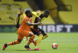 Watford's Ismaila Sarr, right, duels for the ball with Newcastle's Danny Rose during the English Premier League soccer match between Watford and Newcastle at the Vicarage Road Stadium in Watford, England, Saturday, July 11, 2020. (Justin Setterfield/Pool via AP)  XDMV126