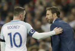 England's Wayne Rooney, left, talks to England's interim manager Gareth Southgate during the World Cup group F qualifying soccer match between England and Scotland at the Wembley stadium, London, Friday, Nov. 11, 2016. (AP Photo/Matt Dunham)