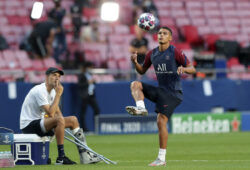 PSG's head coach Thomas Tuchel watches Thiago Silva play with a ball during a training session at the Luz stadium in Lisbon, Saturday Aug. 22, 2020. PSG will play Bayern Munich in the Champions League final soccer match on Sunday. (Miguel A. Lopes/Pool via AP)  XAF193