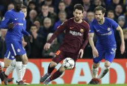 Barcelona's Lionel Messi fights for the ball against Chelsea's Cesc Fabregas during a Champions League round of sixteen first leg soccer match between FC Barcelona and Chelsea at Stamford Bridge stadium in London, Tuesday, Feb. 20, 2018. (AP Photo/Alastair Grant)