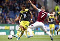 Southampton's Che Adams, left, and Burnley's Johann Berg Gudmundsson compete for the ball during the English Premier League soccer match between Burnley and Southampton at the Turf Moore stadium, Burnley, England. Saturday, Aug, 10 2019 (Martin Rickett/PA via AP)