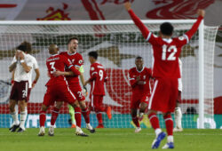 Liverpool's Diogo Jota, third left, is congratulated by teammate Fabinho after scoring his team's third goal during the English Premier League soccer match between Liverpool and Arsenal at Anfield in Liverpool, England, Monday, Sept. 28, 2020. (Jason Cairnduff/Pool via AP)  XMB200