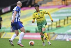 Norwich City's Jamal Lewis, right, takes on Brighton's Aaron Mooy during the English Premier League soccer match between Norwich City and Brighton & Hove Albion at Carrow Road Stadium in Norwich, England, Saturday, July 4, 2020. (Justin Setterfield/Pool Photo via AP)  FP122