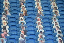 Cutout photos of Brighton fans fill the empty stands during the English Premier League soccer match between Brighton and Newcastle United at the American Express Community Stadium in Brighton, England, Monday, July 20, 2020. (Glyn Kirk/Pool via AP)  HAS102