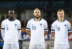 epa07641920 (L-R) Finland's Glen Kamara, Teemu Pukki and Jere Uronen during the national anthem before the UEFA Euro 2020 Group J qualifying soccer match between Liechtenstein and Finland in Vaduz, Liechtenstein, 11 June 2019.  EPA-EFE/GIAN EHRENZELLER
