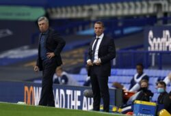 Leicester's manager Brendan Rodgers, right, and Everton's manager Carlo Ancelotti watch their players during the English Premier League soccer match between Everton and Leicester at Goodison Park in Liverpool, England, Wednesday, July 1, 2020. (AP Photo/Jon Super, Pool)  XTS138