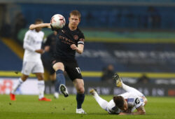 Manchester City's Kevin De Bruyne controls the ball as Leeds United's Kalvin Phillips falls down during the English Premier League soccer match between Leeds United and Manchester City at Elland Road in Leeds, England, Saturday, Oct. 3, 2020. (Jason Cairnduff/Pool via AP)  XAF123