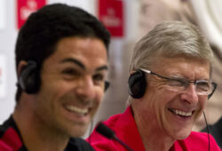 """British soccer club Arsenal's coach Arsene Wenger, right, and midfielder Mikel Arteta smile during a press conference in Beijing Wednesday, July 25, 2012. Arsenal will play Manchester City at China's National Stadium, also known as the """"Bird's Nest,"""" in the Chinese capital on Friday, July 27. (AP Photo/Alexander F. Yuan)"""