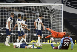 Tottenham players watch as goalkeeper Hugo Lloris, background right, fails to stop West Ham's third goal during the English Premier League soccer match between Tottenham Hotspur and West Ham United at the Tottenham Hotspur Stadium in London, England, Sunday, Oct. 18, 2020. (Neill Hall/Pool via AP)  XAF217