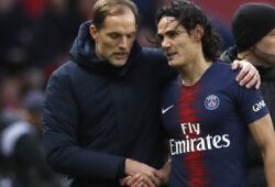SG coach Thomas Tuchel, left, speaks with PSG's Edinson Cavani as he leaves the pitch during the French League One soccer match between Paris Saint-Germain and Bordeaux at the Parc des Princes stadium in Paris, Saturday, Feb. 9, 2019. (AP Photo/Christophe Ena)