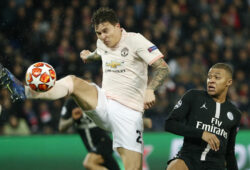 Manchester United's Victor Lindelof, left, clears the ball in front PSG forward Kylian Mbappe during the Champions League round of 16, 2nd leg, soccer match between Paris Saint Germain and Manchester United at the Parc des Princes stadium in Paris, France, Wednesday, March. 6, 2019. (AP Photo/Thibault Camus)