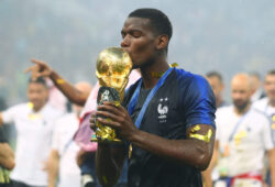 Mandatory Credit: Photo by Kieran Mcmanus/BPI/REX (9762196fz) Paul Pogba of France kisses the FIFA World Cup trophy while holding his shin pads that have an image of his late father on them France v Croatia, Final, 2018 FIFA World Cup football match, Luzhniki Stadium, Moscow, Russia - 15 Jul 2018