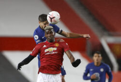 Manchester United's Paul Pogba, front, jumps for the ball with Chelsea's Cesar Azpilicueta during the English Premier League soccer match between Manchester United and Chelsea, at the Old Trafford stadium in Manchester, England, Saturday, Oct. 24, 2020. (Phil Noble/Pool via AP)  XDMV177