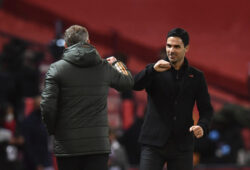 Arsenal's manager Mikel Arteta, right, cheers Manchester United's manager Ole Gunnar Solskjaer end of the English Premier League soccer match between Manchester United and Arsenal at the Old Trafford stadium in Manchester, England, Sunday, Nov. 1, 2020. (Paul Ellis/Pool via AP)  HAS219