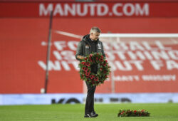 Manchester United's manager Ole Gunnar Solskjaer carry out a wreath before kick-off in the English Premier League soccer match between Manchester United and Arsenal at the Old Trafford stadium in Manchester, England, Sunday, Nov. 1, 2020. (Paul Ellis/Pool via AP)  HAS116