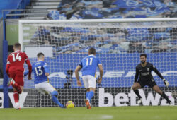 Brighton's Pascal Gross, second from left, scores the equalizer on a penalty kick during the English Premier League soccer match between Brighton and Hove Albion and Liverpool at the Amex stadium in Brighton, England, Saturday, Nov. 28, 2020. (AP Photo/Kirsty Wiglesworth, Pool)  XKW170