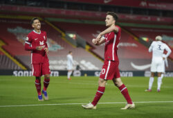 Liverpool's Diogo Jota, center, celebrates after scoring his sides second goal during the English Premier League soccer match between Liverpool and Leicester City at Anfield stadium in Liverpool, England, Sunday, Nov. 22, 2020. (AP Photo/Jon Super)  XPAG132